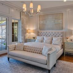 The Chic Technique:  Stunning neutral bedroom with tufted headboard, chandelier and chesterfield sofa.
