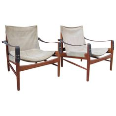 Pair of Hans Olsen 1960s Safari Chairs   From a unique collection of antique and modern armchairs at https://www.1stdibs.com/furniture/seating/armchairs/