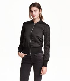 Padded pilot jacket in woven satin fabric. Front zip, side pockets, and quilted sleeves. Ribbing with a slight sheen at neckline, cuffs, and hem. Lined.