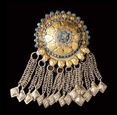 Afghanistan | Pendant. Metal sheet, gold plated appliqués, set with small turquoise glass stones. | Est. 250 - 400 € ~ (Mar '08)