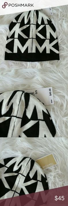 GOING AWAY BUY NOWMichael Kors Beanie NWT Brand new with tags Michael Kors beanie with oversized MK logos! Colors black and white Great gift idea Michael Kors Accessories Hats