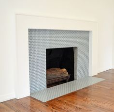 Image result for subway tile on a fireplace surround Mosaic Tile Fireplace, Subway Tile Fireplace, Fireplace Tile Surround, Limestone Fireplace, Fireplace Surrounds, Fireplace Design, Stone Mantel, Simple Fireplace, Home Fireplace