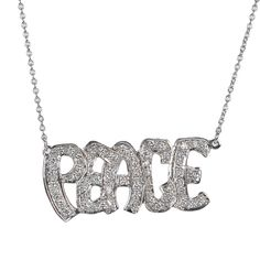 """White diamonds and 14K white gold spell """"peace"""" in this edgy-chic necklace by Catherine Angiel  http://www.fragments.com/peace-graffiti-necklace-catherine-angiel-1.html?___store=default"""