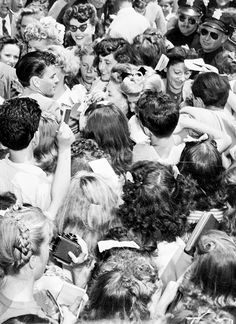 Frank Sinatra makes his way through the crowd after arriving by train in Hollywood to make his first movie, 1943