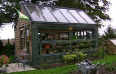 Rather than building a stand-alone greenhouse of plastic, you can have a sturdier, less-expensive and warmer greenhouse of real wood, metal and glass by....