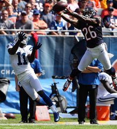 Chicago Bears cornerback Tim Jennings grabs an interception from Indianapolis Colts quarterback Andrew Luck during the second quarter of the season opener at Soldier Field.