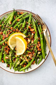 These Garlic Sautéed Green Beans are tossed in a homemade dijon vinaigrette and paired with toasted almonds, parsley, and lemon. It& an easy, healthy and incredibly flavourful green bean side dish, ready in under 30 minutes! Vegetable Sides, Vegetable Side Dishes, Healthy Side Dishes, Side Dish Recipes, Veg Recipes, Healthy Recipes, Sauteed Green Beans, Garlic Green Beans, Green Beans Nutrition
