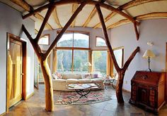 "For those who love the forest and want to bring the trees indoors, whole tree or roundwood construction techniques are used to provide these natural lines. This picture is from Whole Tree Construction FB page. This type of statement is ""doable"" with most natural building styles. www.cordwoodconstruction.org"