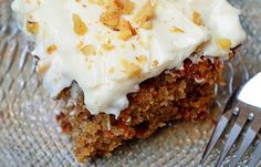 Ingredients:  Cake:  4 eggs  1 1/4 cups vegetable oil  2 cups white sugar  2 teaspoons vanilla extract  2 cups all-purpose flour  2 teaspoons baking soda  2 teaspoons baking powder  1/2 teaspoon salt  2 teaspoons ground cinnamon  3 cups grated carrots  1 cup chopped pecans    Frosting:  1/2 cup butter, softened  8