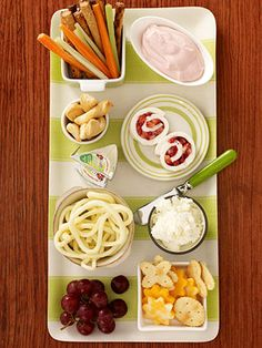 Kiddie Cheese Tray -      Sure, put out some trays of Brie and Camembert for the adults. But don't forget about your younger guests: Make a separate cheese tray filled with string and cheddar cheeses, grapes, carrot sticks, and other munchies that kids love.