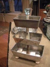 Great display piece for food, jewelry, etc.  Three loaf pans, spindle, door knob.  Like!