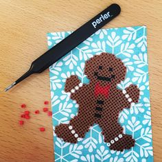 Gingerbread man - Christmas mini perler beads by estumbo