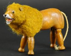 The early Schoenhut lion, with glass eyes and a furry mane. Antique Toys, Vintage Toys, Humpty Dumpty, Plastic Glass, Toy Craft, Pet Toys, Kids Playing, Cow, Lion Sculpture
