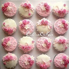 Adorable Pink & White cupcakes with the beautiful roses by ChiQue Cakes!