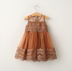 Gorgeous chocolate colored lace dress. Color may appear darker in person.