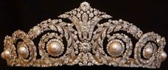 Cartier diamond and pearl tiara. The tiara iscomposedof swirls of diamonds surrounding eight large pearls. This gem belonged to Queen Victoria Eugenia, born a princess of Battenberg. One of the many grandchildren of Queen Victoria, she married King Alfonso XIII of Spain in 1906.