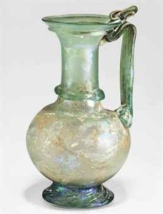 A ROMAN GLASS JUG CIRCA 3RD-4TH CENTURY A.D.