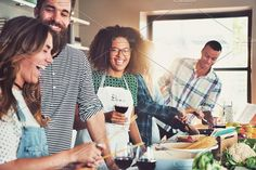 Group of diverse friends drinking and cooking. People Photos. $14.00