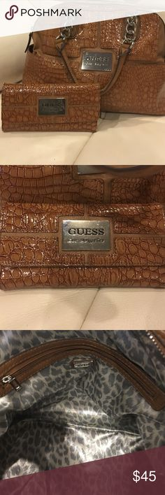 Guess Handbag Wallet Included Guess handbag is in good condition. Wallet had more use which is shown in the pictures but still in good use. Guess Bags
