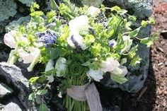 Awesome wild green, white, and a speck of blue wedding bouquet  -from eleganceandsimplicity.com