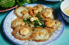 "I traveled to Vũng Tàu - a seaside city in Southern Vietnam and had chance to try a famous dish named: Bánh Khọt (  a southern specialty consisting of small, fried rice flour pancakes filled with shrimps and eat with fish sauce dressing)  If you visit Vũng Tàu, you should try Bánh Khọt at a small but famous diner named: ""Bánh Khọt Gốc Vũ Sữa"" ( Bánh Khọt at Star Apple Tree Stool) at 14 Nguyen Truong To street. Or ""Quan Ba Hai"" at  376/27 Le Loi street, Vung Tau."