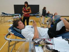 Senior Jarek Beegan donates for former classmates. — at Centerville High School.