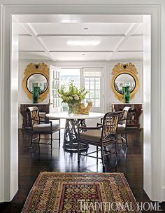 A functional round table with an iron base in the center of the living room provides a spot for dining or for grandkids to draw. - Photo: Eric Roth / Design: Susan Zises Green