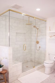 white + brass bathroom
