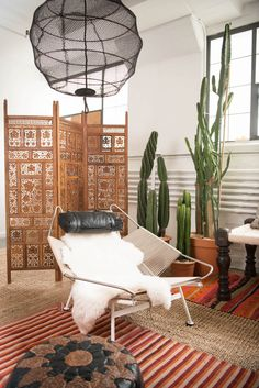 The Wegner Chair looking bad-ass in front of our moroccan screen + a cluster of cacti in the studio   Patina