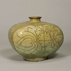 Punch'ong Ware with Lotus Design Incised through Brushed White Slip  Josen Dynasty  This flask was made by throwing a bottle form on the wheel, then paddling and trimming.