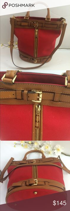 Michael Kors tote lipstick red canvas bucket RARE! A unique rare bag, NEW no tags, Michael Kors tote lipstick red canvas bucket w brown/tan leather trim and gold hardware.  100% authentic new condition, got as a gift and never used it. Large bag w plenty of room inside. Side zip pocket, open pocket in the back, w two handles and adjustable strap Michael Kors Bags Totes