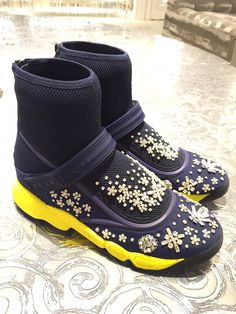 High ankle Dior Sneakers.