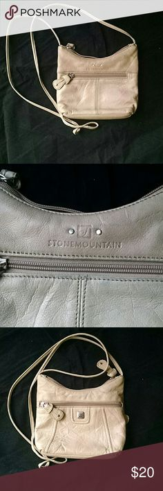 Stone Mountain Genuine Leather Small Crossbody Pur Small Stone Mountain cross body purse. Perfect for that quick get away. Light and soft leather with a beautiful purple satin on the inside. This purse will not be heavy around your neck like some do. This is a great choice for you! Stone Mountain Bags Crossbody Bags