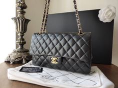 """#Chanel Classic 10"""" Flap in Black Lambskin with Gold Hardware > http://www.naughtipidginsnest.co.uk/naughtipidginsnestshop/prod_3466366-Chanel-255-Classic-10-Black-Lambskin-Flap.html"""