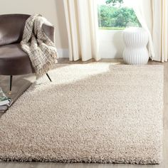 Rug from Reno Shag collection. Inspired by western mountain chalets, Safavieh's Reno shag rug, is a beige plush shag power-loomed of synthetic yarns for an easy-care carpet. Cream Area Rug, White Area Rug, Beige Area Rugs, White Beige, Light Beige, Gray, Dark Grey, Indie, Polyester Rugs