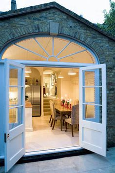 Blue French doors. Wonder if I could modify the sunroom to make it look like that.