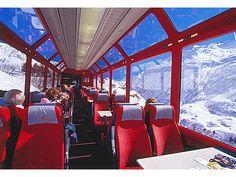 J'irais a les Alpes suisses par train.