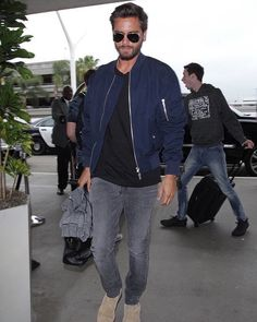 241a77f185423 Scott Disick wears trendy navy bomber jacket as he jets out of LAX