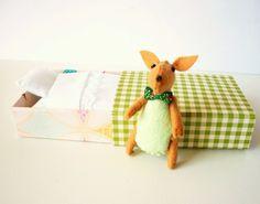 http://www.etsy.com/listing/93991599/easter-bunny-plush-green?ref=v1_other_2