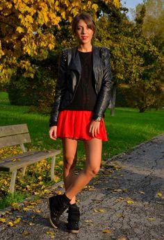 Leather jacket, black tee, bright skater skirt, wedge sneakers