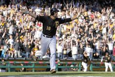 3/31/14 - PITTSBURGH, PA - MARCH 31: Neil Walker #18 of the Pittsburgh Pirates celebrates after hitting a walk off solo home run in the tenth inning against the Chicago Cubs during Opening Day at PNC Park March 31, 2014 in Pittsburgh, Pennsylvania. (Photo by Justin K. Aller/Getty Images)