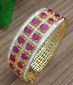Classy elegant Bollywood gold plated CZ AD designer ruby American Diamond wedding party Bangles for womens and girls. Ruby Bangles, Bridal Bangles, Gold Bangles, Bridal Jewelry, Hair Jewelry, Gold Jewelry, Jewelery, Gold Earrings Designs, Gold Jewellery Design