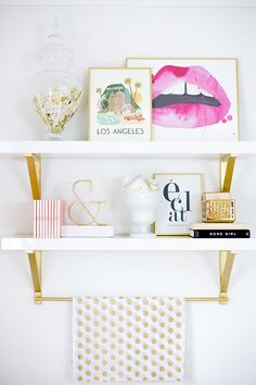Hot pink and gold styled shelves.
