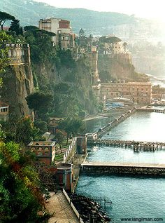 Sorrento, Italy Sorrento's charm lies in its sun drenched rustic simplicity, Quaint artisan workshops sit packed together onto a maze of medieval alleys of uneven cobbled streets. With amazing views of the Naples bay, it's not hard to see why tourist flock to Italy's City By The Bay.