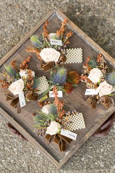 Don't like corsages, but the colors are so pretty! blues and oranges