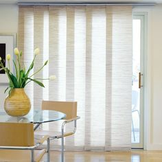 panel track blinds for the balcony door - would be smart to have them split in the middle
