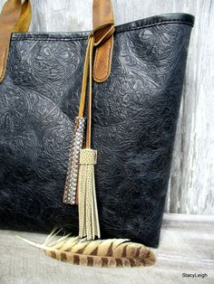 """Black leather tote from """"tooled"""" leather."""