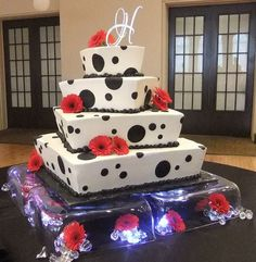 Four tier offset square wedding cake with black circles and red flowers.JPG