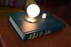 Discarded vintage book that's now a great looking lamp
