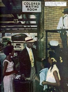 African American professor E.J. Thornton entering a Colored Waiting Room at a bus station   Location:	Mobil, AL, US  Date taken:	1956  Photographer:	Gordon Parks